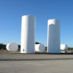 Large agricultural tanks sandblasting in Yuba City California that we then painted